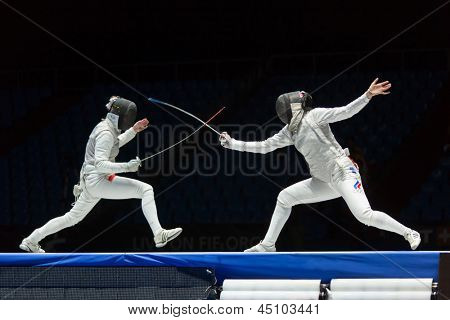 MOSCOW - APR 6: Interesting fight on championship of world in fencing among juniors and cadets, in Sports Olympic complex, on April 6, 2012 in Moscow, Russia