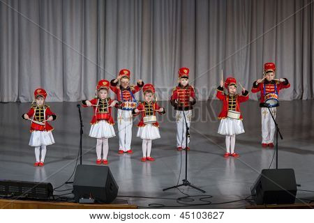 MOSCOW - APR 4: Children dressed as hussars on stage  performs on stage on District Competition Crystal droplet on April 7, 2012 in Moscow, Russia.