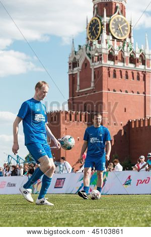 MOSCOW - MAY 26: Football players warm up before the game on  VIII Forum Ready for Labor and Defense on May 26, 2012 in Red Square, Moscow, Russia.