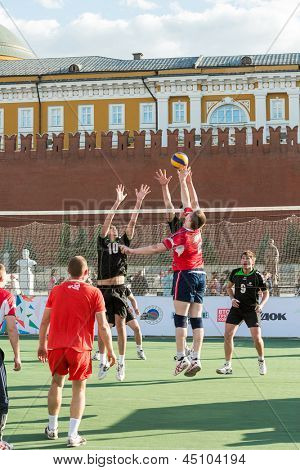 MOSCOW - MAY 26: Two volleyball players try to block the ball on VIII Forum Ready for Labor and Defense on May 26, 2012 in Red Square, Moscow, Russia.