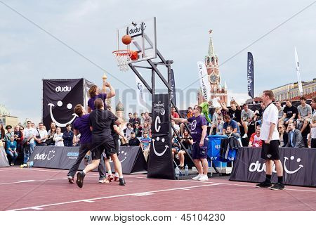 MOSCOW - MAY 27: Game between teams during Dudu Streetbasket fest on Red Square, May 27, 2012, Moscow, Russia. Association Streetball Russia is one of world leaders in development of street basketball