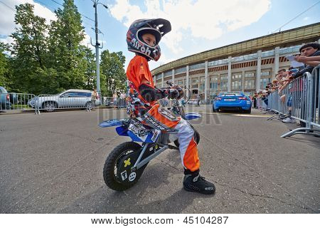 MOSCOW - JUN 30: Juvenile participant of Speedfest at Luzhniki in motorcyclist outfit, June 30, 2012, Moscow, Russia. Festival brought together about 7000 people.