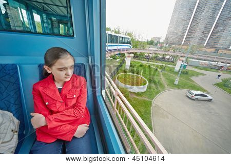 MOSCOW - MAY 14: Teenage-girl rides in carriage of Moscow monorail system, May 14, 2012, Moscow, Russia. Totally there is six carriages in train, and capacity up to 290 people.