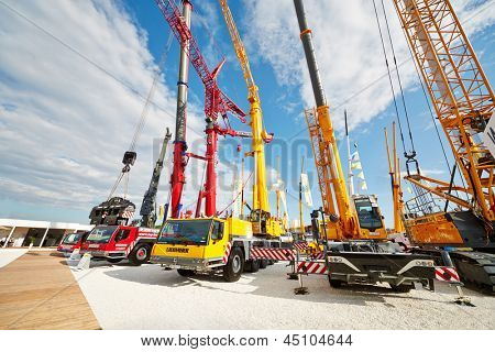 MOSCOW - MAY 29: Cranetrucks and caterpillar cranes at 13th International Specialized Exhibition CET 2012 at the international exhibition center Crocus Expo, May 29, 2012, Moscow, Russia.