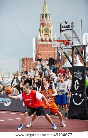 MOSCOW - MAY 27: People watch game during Dudu Streetbasket fest on Red Square, May 27, 2012, Moscow, Russia. Association Streetball Russia is one of world leaders in development of street basketball.