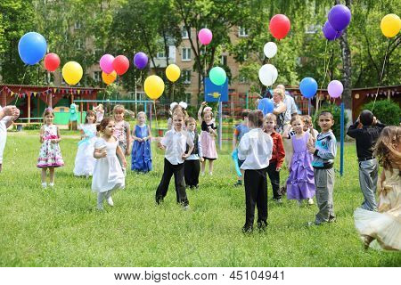 MOSCOW - MAY 22: Children with balloons in kindergarten 1042 at party, on May 22, 2012 in Moscow, Russia. In 2013 in Moscow will open 34 new kindergartens.