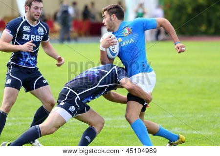 MOSCOW - JUNE 30: Men take part in second stage of European championship on rugby-7 in sports complex Luzhniki, June 30, 2012, Moscow, Russia. Athletes from Italy in blue, from Scotland in black.
