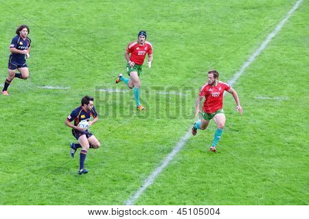 MOSCOW - JUNE 30: Rugby players run at fighting for ball on second stage of European championship on rugby-7 in sports complex Luzhniki, on June 30, 2012 in Moscow, Russia.