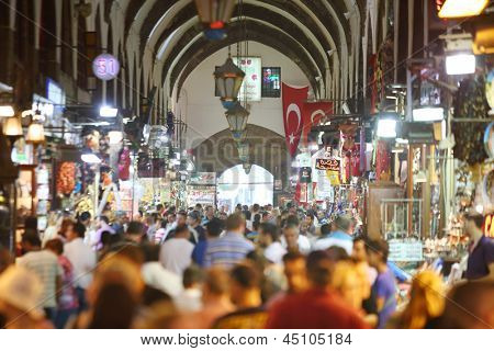 ISTANBUL - JULY 4: Tourists in Egyptian Bazaar, on July 4, 2012 in Istanbul, Turkey. Turkey - Russia leading outbound tourism in 2012, according to Russian Federal Tourism Agency.