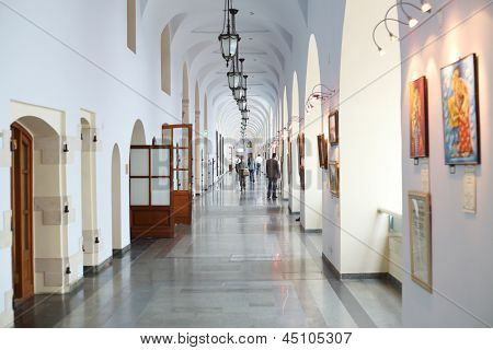 MOSCOW - MAY 23: People walk in Gostiny Dvor, May 23, 2012 in Moscow, Russia. At end of XVIII Italian architector Giacomo Quarenghi rebuilts Gostiny Dvor in single building with elegant architecture.