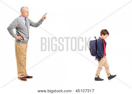 Full length portrait of a grandfather reprimanding a little boy, isolated on white background
