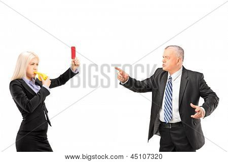 Professional woman showing a red card and blowing a whistle to her boss, isolated on white background