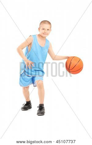 Full length portrait of a child playing with a basketball isolated against white background