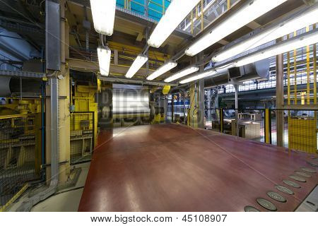 Aluminum rotates on machine in workshop on rolling mill