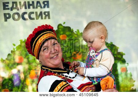 VINNICI, LENINGRAD REGION, RUSSIA - JUNE 10: Unknown kid during celebrate the annual holiday Vepsian national culture Tree of Life, June 10, 2012 in the village Vinnici, Russia.