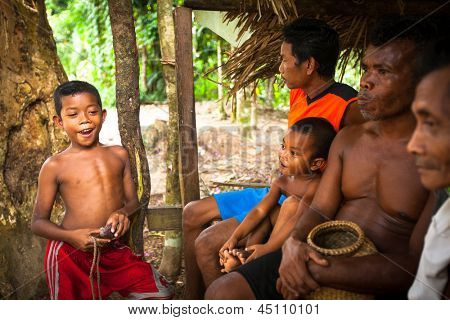 BERDUT, MALAYSIA - APR 8: Unidentified children Orang Asli in his village on Apr 8, 2013 in Berdut, Malaysia. More than 76% of all Orang Asli live below the poverty line, life expectancy - 53 years.