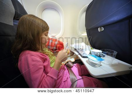 Girl with empty boxes of food for the plane