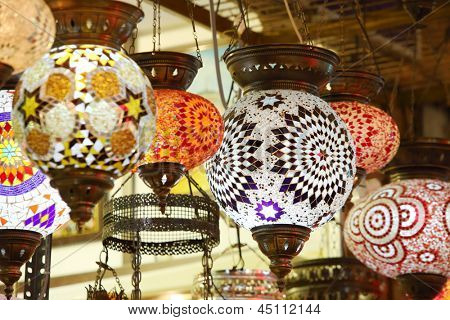 Beautiful lights hanging in tent of merchant in Central Asian market.