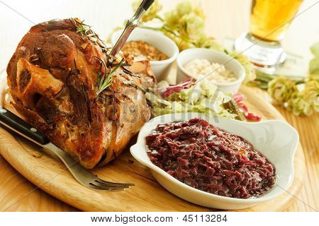 eisbein with braised cabbage, mashed potato, and beer
