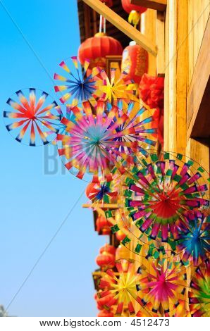 Colorful Rainbow Toy Pinwheels And Red Lantern