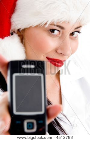 Female With Christmas Hat And Showing Cell Phone