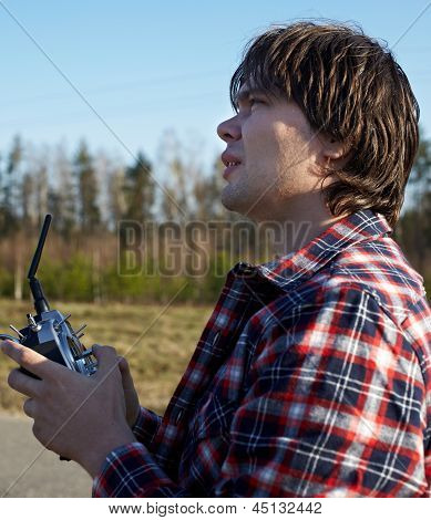 Young man controls RC plane in the sky