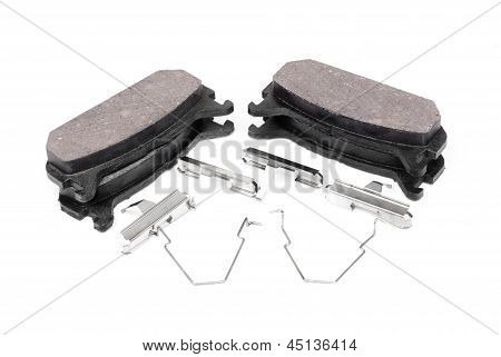 Four Brake Pads And Spring, Isolatet On White