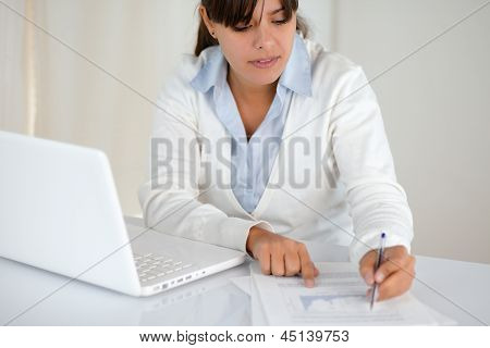 Charming Young Female Reading Documents At Office