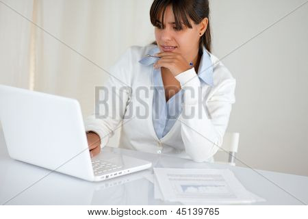 Pretty Young Woman Reading The Laptop Screen