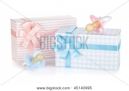 Gift box and pacifier for little boy and girl. Isolated on white background