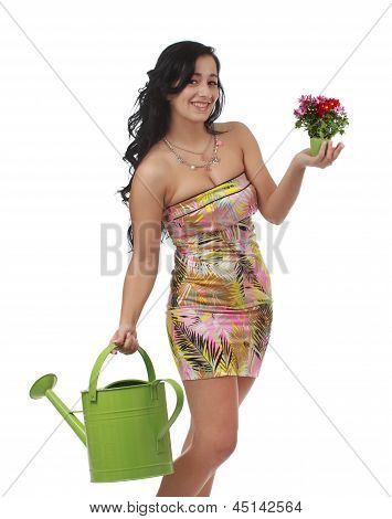 Woman Holding Water Can And Flowers