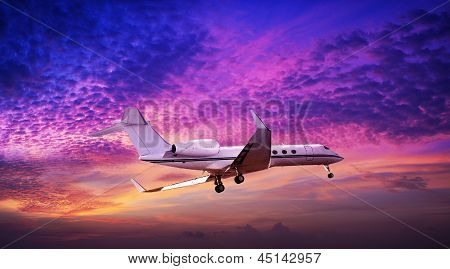 Private jet In A Sunset Sky