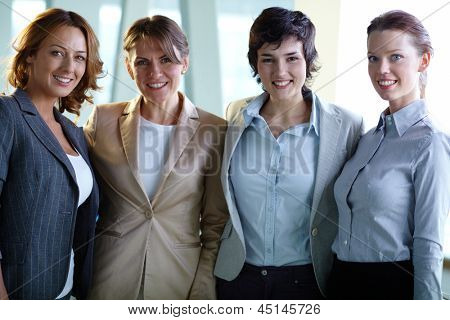 Image of four successful businesswomen looking at camera