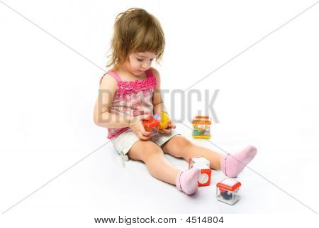 Girl Playing With Her Toys