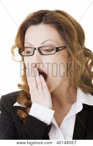 Tired business woman in a suit ,isolated over white background