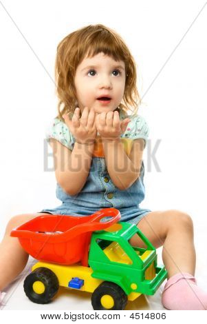 Cute One Year Old Girl Playing With Her Toys