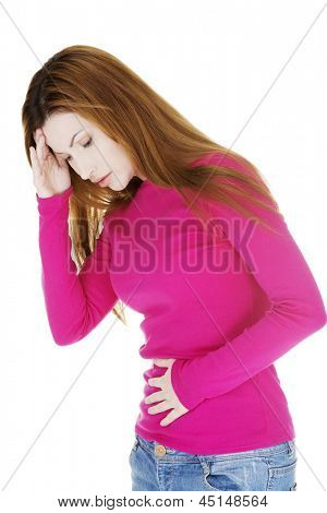 Woman with strong pain of stomach and nausea , isolated on white