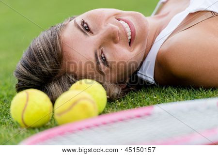Portrait of a beautiful tennis player smiling