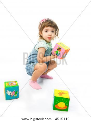 Girl Playing With Toys On The Floor