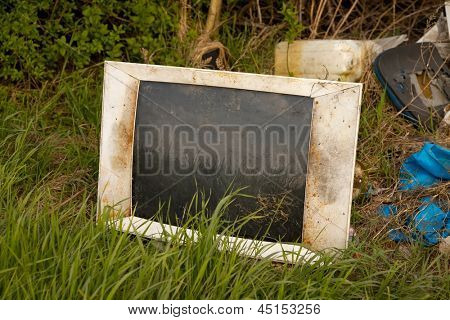 Discarded old TV set on a field
