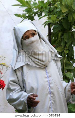 Old Moroccan Woman Wearing A Djellaba