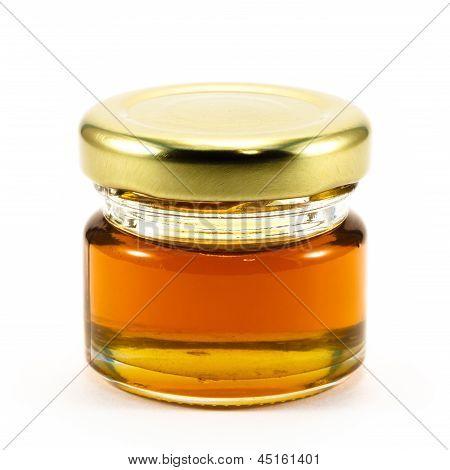 Honey In The Bottle Glass