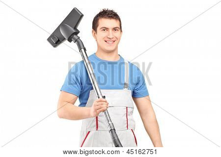 A young male worker holding a vacuum cleaner isolated on white background