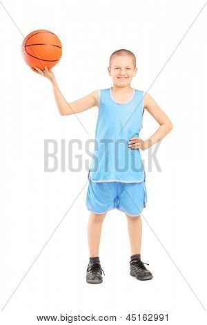 Full length portrait of a smiling child holding a basketball isolated on white background