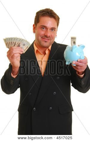Business Man Holding A Money And A Piggy Bank