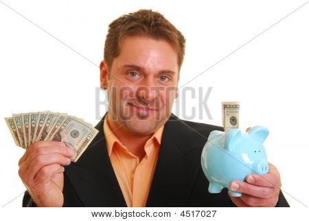 Bussiness Man Holding A Money And A Piggy Bank