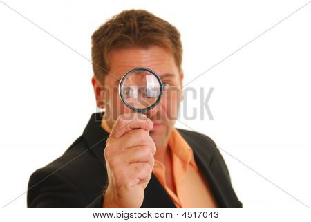 Business Man Holding A Magnifying Glass