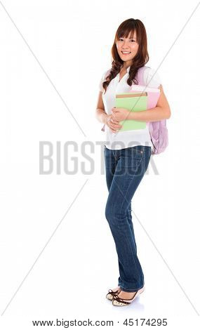 Full body portrait of smiling Asian female young adult student standing isolated on white background