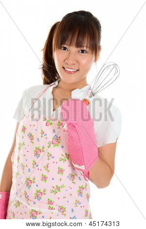 Beautiful Asian girl holding egg beater and smile, isolated on white