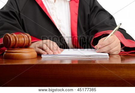 Female judge writing the verdict isolated on white background